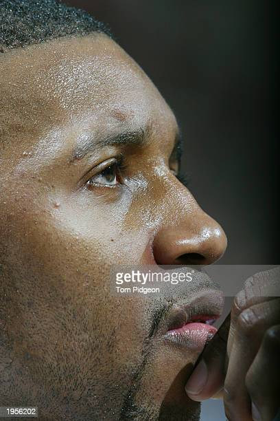 Tracy McGrady of the Orlando Magic watches Game one of the Eastern Conference Quarterfinals during the 2003 NBA Playoffs against the Detroit Pistons...