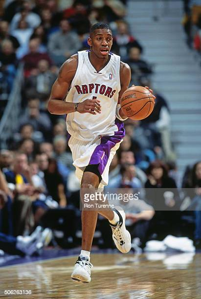 Tracy McGrady of the Toronto Raptors drives against the Indiana Pacers on December 14 1999 at the Air Canada Centre in Toronto Ontario in Canada NOTE...
