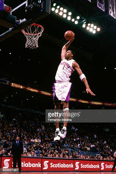 Tracy McGrady of the Toronto Raptors dunks circa 2000 at the Air Canada Centre in Toronto Ontario NOTE TO USER User expressly acknowledges and agrees...