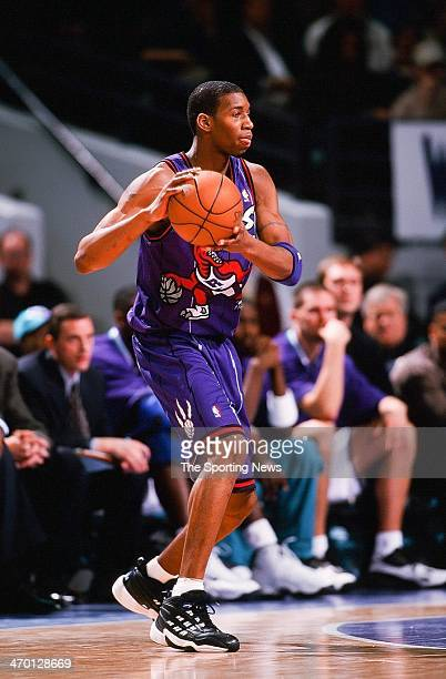 Tracy McGrady of the Toronto Raptors during the game against the Charlotte Hornets on March 1 1999 at Charlotte Coliseum in Charlotte North Carolina