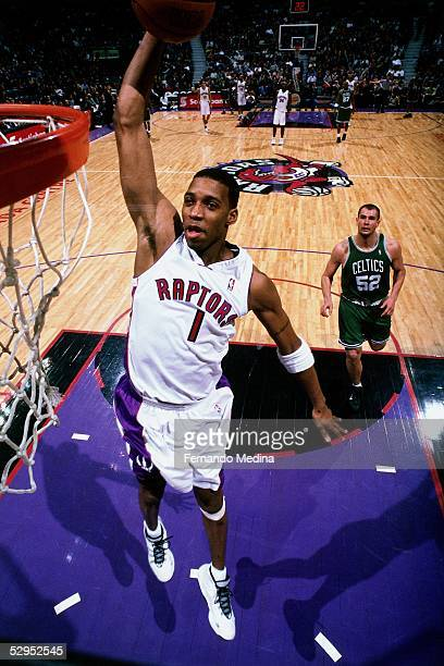 Tracy McGrady of the Toronto Raptors goes for a dunk against the Boston celtics during an NBA game at the Air Canada Center in Toronto, Ontario,...