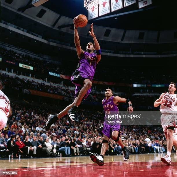 Tracy McGrady of the Toronto Raptors goes for a layup against the Chicago Bulls during an NBA game at the United Center circa 2000 in Chicago...