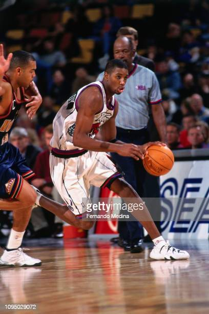 Tracy McGrady of the Toronto Raptors handles the ball against the Denver Nuggets on March 19 1998 at the Air Canada Centre in Toronto Canada NOTE TO...