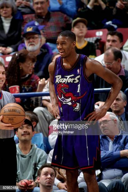 Tracy McGrady of the Toronto Raptors talks to a referee during an NBA game against the Sacramento Kings circa 1999 in Sacramento California NOTE TO...