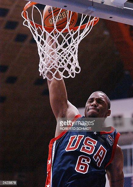 Tracy McGrady of the US closes his eyes as he dunks a ball to score two points in his team's first round game against Venezuela at the Roberto...