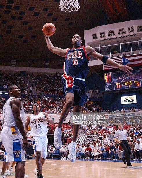 Tracy McGrady of the US goes up for a slam dunk in his team's first round game against the US Virgin Islands during the FIBA Americas Men's...