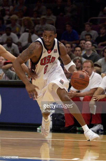 Tracy McGrady of the USA handles the ball against the Puerto Rico Senior National Team on August 17, 2003 at Madison Square Garden in New York, New...