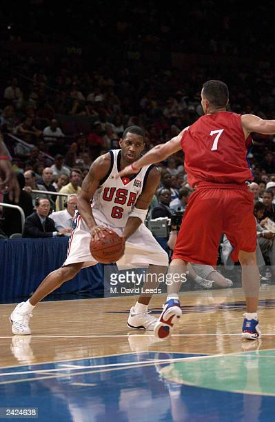 Tracy McGrady of the USA looks to get past the defense of Carlos Arroyo of Puerto Rico during an exhibition game on August 17, 2003 at Madison Square...