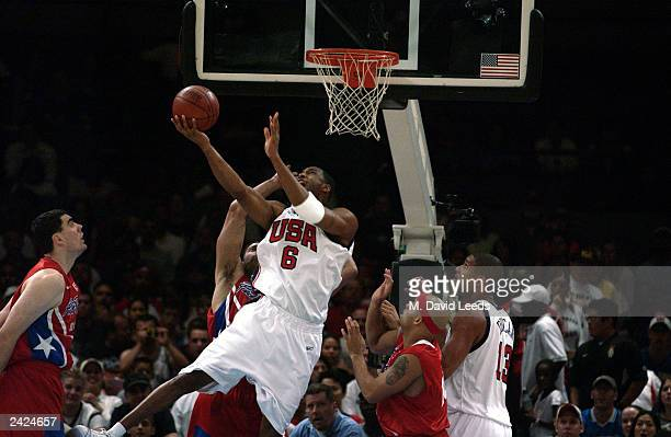Tracy McGrady of the USA scores in traffic against Puerto Rico during an exhibition game on August 17, 2003 at Madison Square Garden in New York, New...