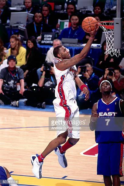 Tracy McGrady of the Western Conference AllStars shoots against Jermaine O'Neal of the Eastern Conference AllStars during the 2005 AllStar Game on...