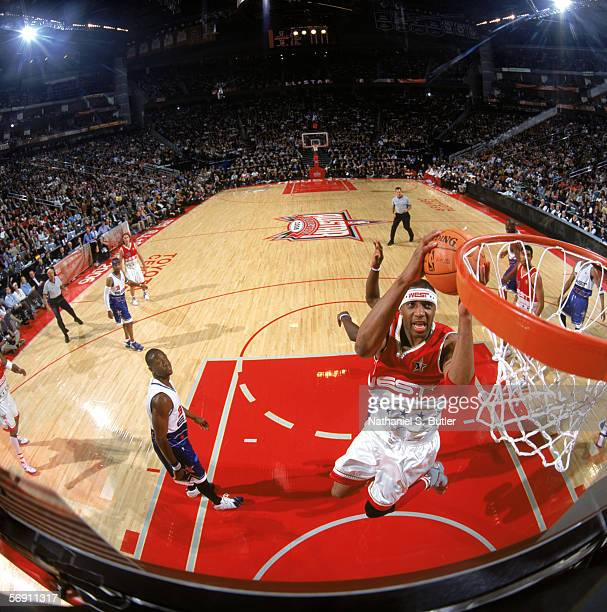 Tracy McGrady of the Western Conference takes the ball to the basket during the 2006 NBA AllStar Game against the Eastern Conference at Toyota Center...