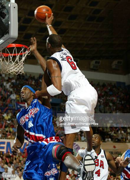 Tracy McGrady shoots over Sharif Fajardo of Puerto Rico during the U.S. Versus Puerto Rico semifinal Olympic qualifying game on August 30, 2003 at...