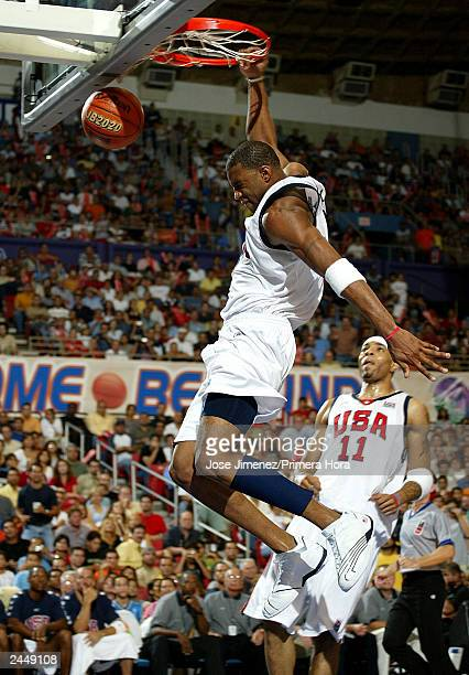 Tracy McGrady slam dunks during the U.S. Versus Puerto Rico semifinal Olympic qualifying game on August 30, 2003 at Roberto Clemente Coliseum in San...