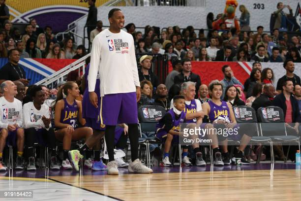Tracy McGrady smiles from the bench during the NBA AllStar Celebrity Game presented by Ruffles as a part of 2018 NBA AllStar Weekend at the Los...