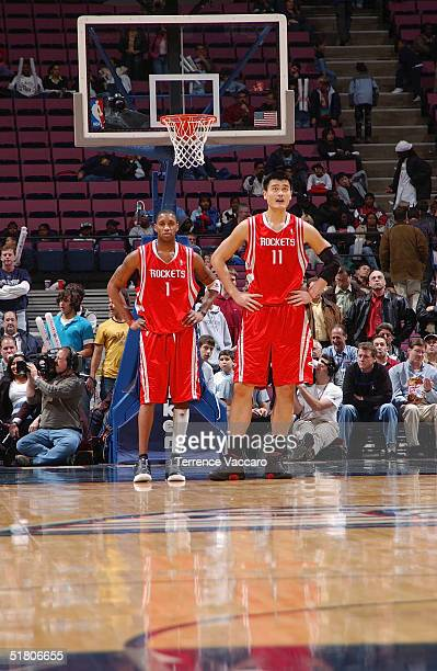 Tracy McGrady stands with Yao Ming of the Houston Rockets during the game against the New Jersey Nets on November 15 2004 at the Continental Airlines...