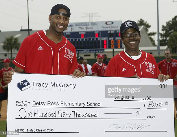 Tracy McGradyleft presents a check for $15000000 to the principal of Betsy Ross Elementary during the Tracy McGrady Foundation 2006 Softball Classic...