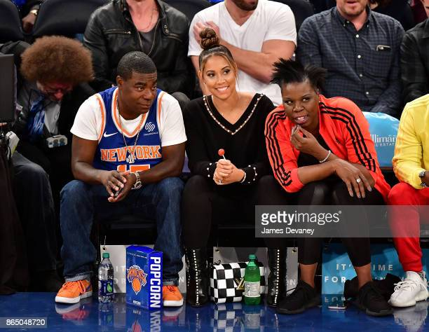 Tracy Morgan Megan Wollover and Leslie Jones attend Detroit Pistons Vs New York Knicks game at Madison Square Garden on October 21 2017 in New York...
