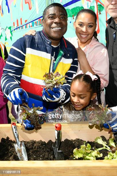 Tracy Morgan Megan Wollover and Maven Sonae Morgan attend The Last OG Season 2 Garden Party For Good at the Hattie Carthan Community Garden in...