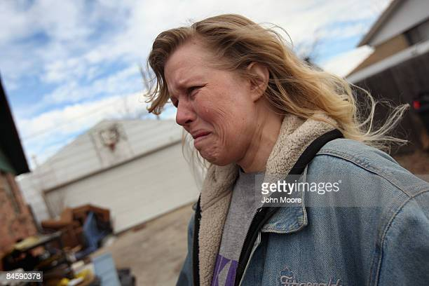 Tracy Munch watches as an eviction team removes furniture from her foreclosed house February 2 2009 in Adams County Colorado She said she and her...