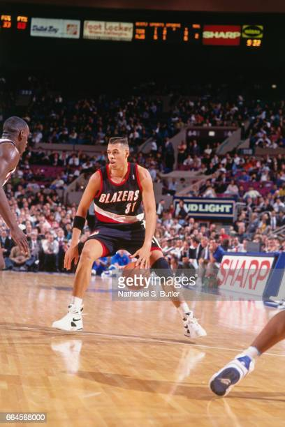 Tracy Murray of the Portland Trail Blazers dribbles against the New York Knicks during a game played circa 1993 at the Madison Square Garden in New...