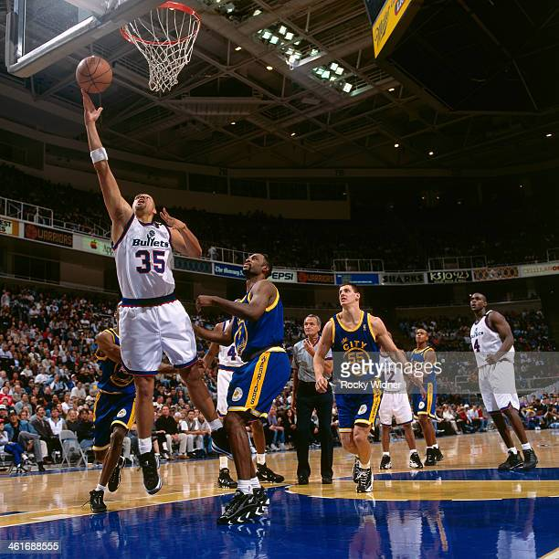 Tracy Murray of the Washington Bullets shoots the ball against the Golden State Warriors during a game played on December 15 1996 at the San Jose...