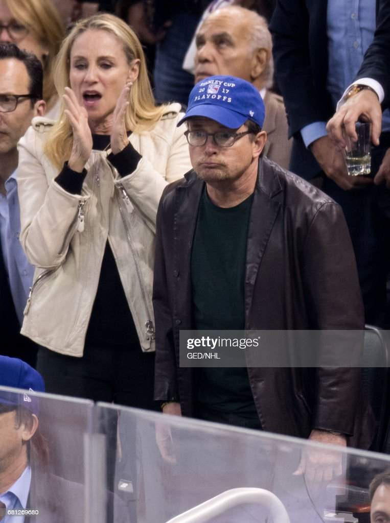 Tracy Pollan and Michael J. Fox attend Ottawa Senators Vs. New York Rangers 2017 Playoff Game on May 9, 2017, at Madison Square Garden in New York City.