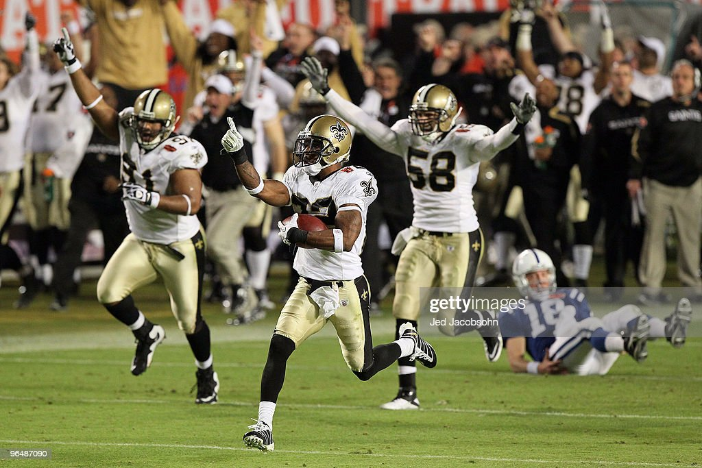 Tracy Porter #22 of the New Orleans Saints intercepts a ball and thrown by Peyton Manning #18 of the Indianapolis Colts and returns it for a touchdown in the fourth quarter during Super Bowl XLIV on February 7, 2010 at Sun Life Stadium in Miami Gardens, Florida.
