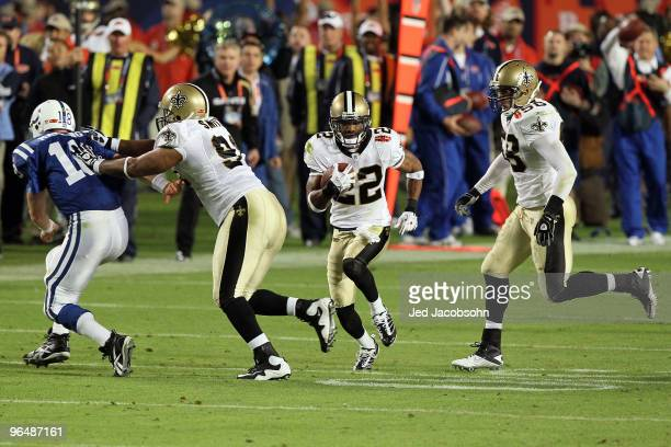 Tracy Porter of the New Orleans Saints intercepts a ball thrown by Peyton Manning of the Indianapolis Colts and returns it for a touchdown in the...
