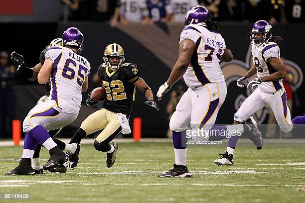 Tracy Porter of the New Orleans Saints intercepts a pass and returns in for positive yards late in the fourth quarter against the Minnesota Vikings...