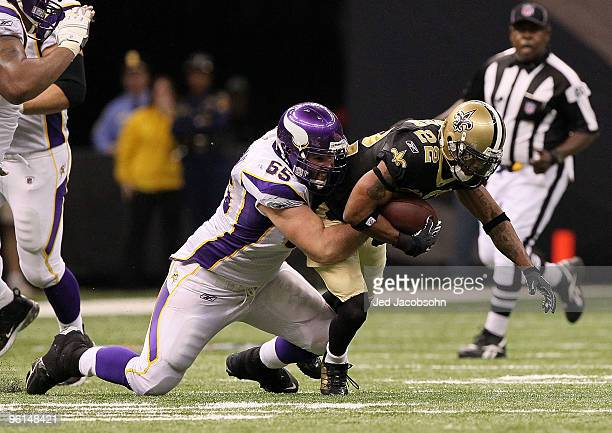 Tracy Porter of the New Orleans Saints intercepts a pass and returns in for positive yards late in the fourth quarter against John Sullivan of the...
