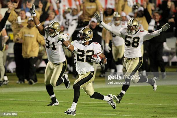 Tracy Porter of the New Orleans Saints intercepts Peyton Manning of the Indianapolis Colts for a touchdown in the fourth quarter during Super Bowl...
