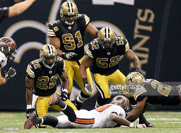 Tracy Porter of the New Orleans Saints kneels just after tackling Mike Williams of the Tampa Bay Buccaneers at MercedesBenz Superdome on November 6...