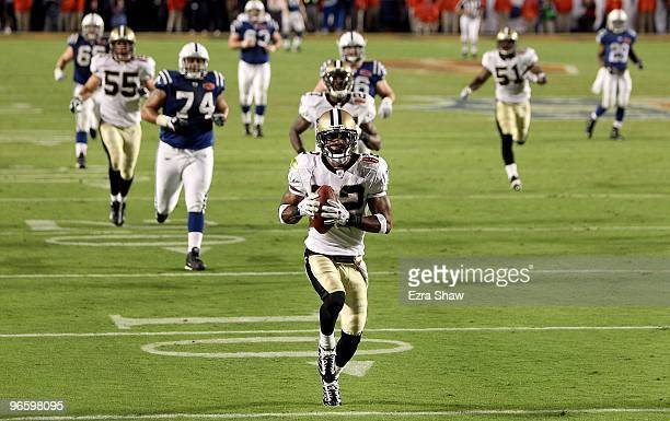 Tracy Porter of the New Orleans Saints returns a interception for a touchdown against of the Indianapolis Colts during Super Bowl XLIV on February 7...
