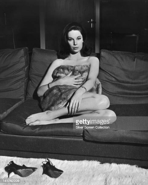 Tracy Reed British actress naked but for a fur wrap sitting on a sofa in a publicity still issued for the film 'Dr Strangelove or How I Learned to...