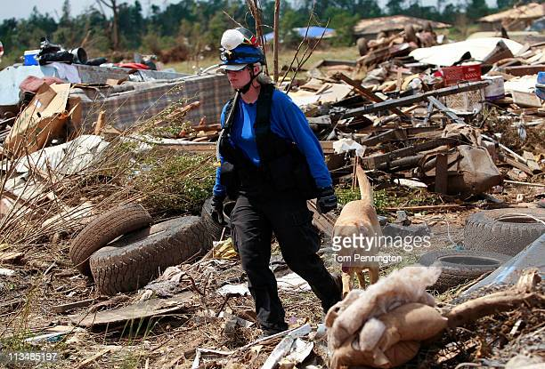 Tracy Sargent, with K9 Search and Rescue Specialists Inc., searches for a body with her dog Chance on May 2, 2011 in Tuscaloosa, Alabama. Alabama,...