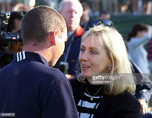 Tracy Stewart , wife of the late golfer Payne Stewart, talks with Sergio Garcia of Spain,14 June 2000, at the US Open in Pebble Beach, California....