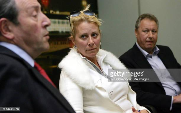 Tracy Wilkinson listens to lawyer Stephen Jakobi with her ex husband Robin at Heathrow Airport after being acquitted of any wrong doing by a court in...