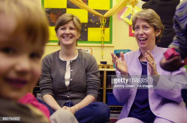 Trade and Industry Secretary Patricia Hewitt sits with children and staff at the First Steps nursery school in Westminster central London on the day...