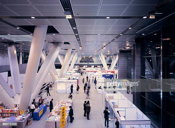 trade fair inside the tokyo international forum. - tradeshow stock pictures, royalty-free photos & images