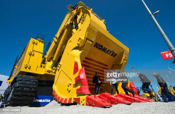 Trade fair visitors stand in one of the largest shovel excavators from Komatsu at the opening of Bauma, the world's largest construction fair, in...