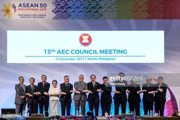 Trade ministers pose for a group photo during the Asean economic council meeting at the Association of Southeast Asian Nations Summit in Pasay the...