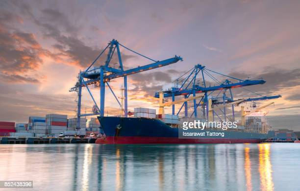trade port at sunrise - industrial sailing craft stock pictures, royalty-free photos & images