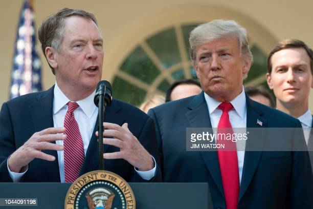 US Trade Rep Robert Lighthizer speaks next to US President Donald Trump remarking on the United States Mexico Canada Agreement from the Rose Garden...