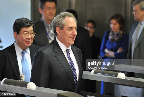 US Trade Representative Michael Froman arrives for a meeting with Japan's Economic and Fiscal Policy Minister Akira Amari at the latter's office in...