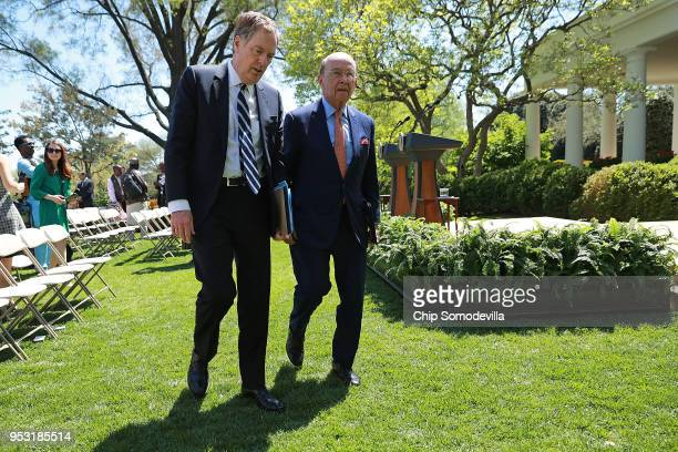S Trade Representative Robert Lighthizer and Commerce Secretary Wilbur Ross leave the Rose Garden following a joint news conference with President...