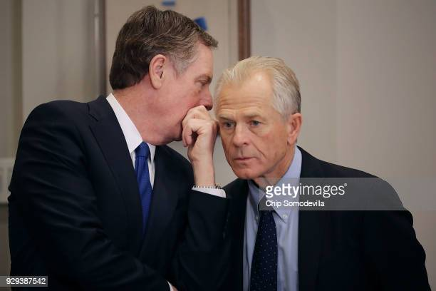 S Trade Representative Robert Lighthizer and White House National Trade Council Director Peter Navarro talk before President Donald Trump signs the...