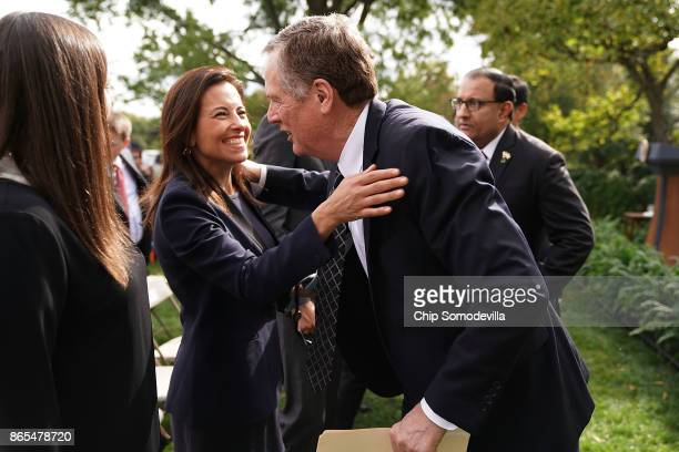 S Trade Representative Robert Lighthizer embraces Deputy National Security Advisor Dina Powell after joint statements by President Donald Trump and...