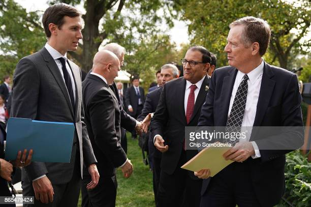 S Trade Representative Robert Lighthizer talks with President Donald Trump's soninlaw and senior advisor Jared Kushner after Trump and Singapore...