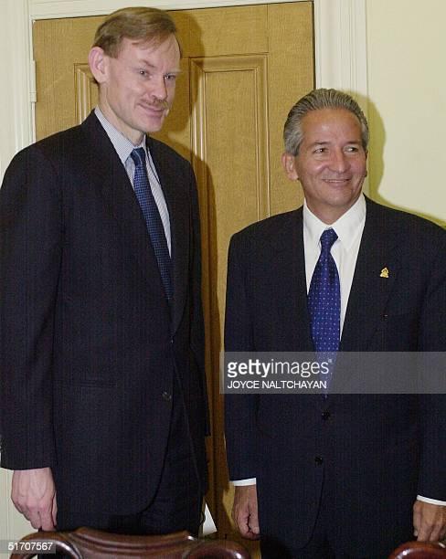Trade Representative Robert Zoellick greets Honduran Presidentelect Ricardo Maduro before their meeting in Washington DC 18 January 2002 The meeting...