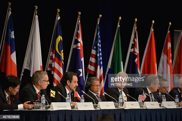 Trade representatives attend at a press conference for the TransPacific Partnership a panPacific trade agreement by trade ministers from 12 nations...